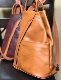 Perfect gift for the adventurous one! It's a smaller backpack and lightweight. Excellent for your wallet, sun glasses, a book or two and a small water bottle. A small inside and outside zip wall pocket can hold your keys. The front slip pocket is great for quick access items. Lots of colors. #traveloutfit #smallbackpackpurse #leatherpurses #fashionbackpacksbags #fashionbackpackspurse #passportholder #onthego #giftforher #giftsforhim #giftideas