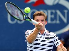 David Goffin of Belgium returns a shot to Simone Bolelli of Italy at the U.S. Open on Aug. 31, 2015.  Jerry Lai-USA TODAY Sports