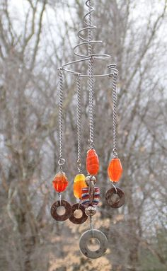 Rustic Glass Beads and Old Washers Wire Wrap Windch - Japanese Garden Design Garden Crafts, Garden Art, Mobiles, Wind Sculptures, Glass Wind Chimes, Japanese Garden Design, Garden Whimsy, Wind Spinners, Painted Jars