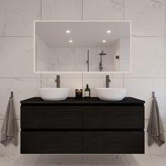 En klassisk og moderne stil med lyse marmorfliser og sorte armatur. Et tidløst rom med rene linjer på servant og badekar som gjør rommet moderne, mens flisvalget gir en elegant og kontinental opplevelse. Med sort eller mørkt tilbehør understrekes stilen ytterligere.