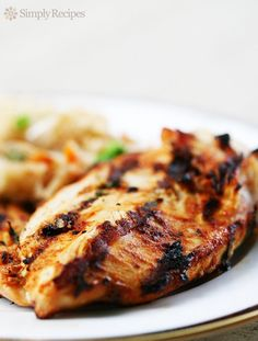 Moroccan Spiced Grilled Chicken Breasts ~ Skinless, boneless, chicken breasts marinated in yogurt with garlic, paprika, and cumin, then grilled. #MemorialDay ~ SimplyRecipes.com
