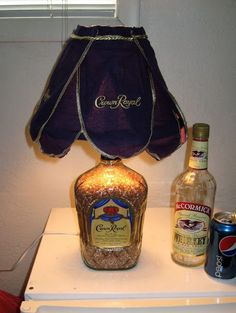 Image 8 of 17 from gallery of Cool DIY Bottle Lamp Ideas To Add Unique Home Decor. This diy liquor bottle nightstand lamp was adorned with crown royal shade and looks chic for classic decoration Liquor Bottle Crafts, Alcohol Bottles, Glass Bottles, Liquor Bottle Lights, Patron Bottles, Empty Liquor Bottles, Crown Royal Bottle, Crown Royal Bags, Diy Bottle Lamp