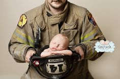 Such a powerful image! Fireman, fire, brave, helmet, fire department, daddy, protector. Tiny Tush Photography, Atlanta. Dixie-Darlings » Newborn Contests & Etsy Giveaways featuring the cutest newborn photography in Memphis, Tn and the entire Mid-South