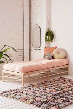 Add boards underneath this frame to create a bookshelf and use in a living room; add another bookshelf at the foot of the daybed to create a nook