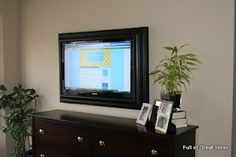 This blog shows step by step for creating and hanging a frame around your TV  Full of Great Ideas: Picture perfect TV - Flat Screen TV Frame