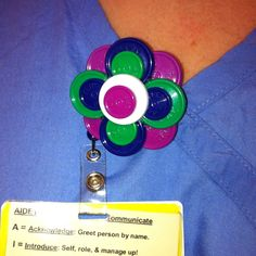 Clever idea to reuse medicine vial caps!  Make I.D. badge holders!