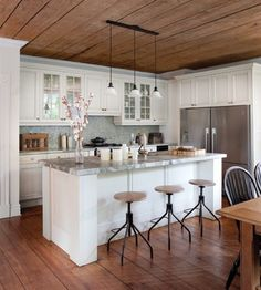 See our website and Facebook page for more information and design ideas! www.carolinawholesalefloors.com    Hardwood ceilings might be a cool way to distinguish the space.  Hardwood floors and hardwood ceiling - nate berkus kitchen makeover