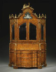 An Italian walnut, burr walnut and parcel-gilt bureau cabinet, Venetian mid 18th century