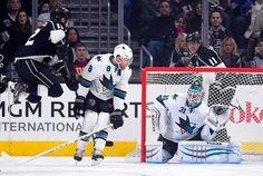 San Jose Sharks goaltender Antti Niemi makes a glove save as forward Joe Pavelski looks on (Dec. 27, 2014).