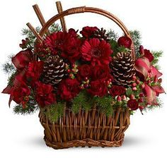 Holiday Spice Basket   TFWEB479      Spice up any Christmas celebration with this delightfully fragrant holiday spice basket, featuring a mix of fresh red blossoms, pinecones and real cinnamon sticks, beautifully arranged in a rustic handled basket. A festive satin ribbon adds an extra touch of cheer.   https://www.4165flower.com/index.asp?pid=4=viewproduct=9995=1