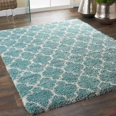 Lofty Trellis Plush Area Rug Sink your toes into this plush rug and enjoy the softness underfoot with eye catching style from a classic trellis pattern in a Moroccan mood. Available in trending shades of Aqua, Gray, Black and Taupe