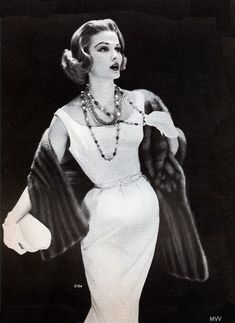 Model wearing a mink stole, 1957.
