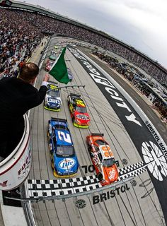 Joey Logano (20) and Kurt Busch lead the field to the green flag to start the March 2010 race. (Ernie Mache/AP)