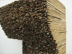 Leonardo Drew uses thousands of wood scraps, assembling multiple towering wall pieces with a monstrous wall that snakes through all four rooms of the gallery.