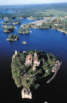 Boldt Castle, Alexandria Bay, Thousand Islands, New York State~ The small village to the right in the middle ground is Clayton NY, home of the Clayton Yacht Club. Photo via Guy Robinson. The Places Youll Go, Cool Places To Visit, Lake George Village, Thousand Islands, Mont Saint Michel, Kirchen, Beautiful Places, Amazing Places, The Great Outdoors