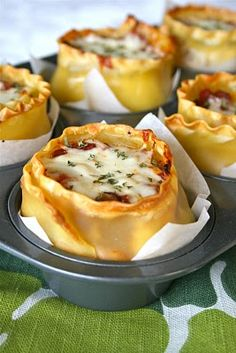 Lasagna Cups. What a great way to keep from having to store a half a pan of lasagna in the fridge. Also super portable for brown bagging it, or a great serving size for a buffet lunch!