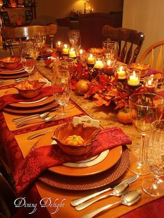 Thanksgiving Dinner Table Decorations leaves and orange candles make for the perfect intimate