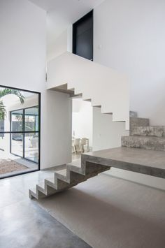 Garcias' House / Warm Architects, stair cases, cream & white