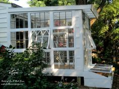 When this blogger spotted a stack of antique windows at a yard sale going for $5 a piece, she snatched them up. She decided to use them to build something she always wanted: A dreamy backyard greenhouse.