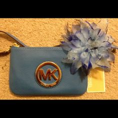 """NWT Michael Kors blue leather wristlet NWT Michael Kors small heritage blue colored leather wristlet.  Purse has the gold hardware MK logo on the front. Measures approx 7"""" in length & 4 1/2"""" in height Michael Kors Bags"""