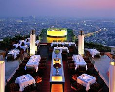 The rooftop Sirocco Restaurant & Sky Bar in Bangkok, Thailand is a place to drink & dine. Sirocco Restaurant & Sky Bar is a hip open-air restaurant and bar. Buffet Restaurant, Restaurant Hotel, Restaurant Design, Restaurant Lighting, Sky Bar Bangkok, Rooftop Bangkok, Bangkok Hotel, The Places Youll Go, Places To Go