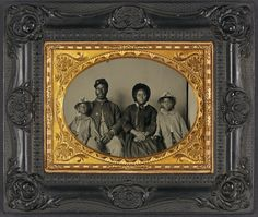 An African-American soldier in Union uniform with wife and two daughters.