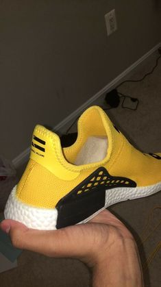 timeless design f61fb aafe8 human race nmd size black and yellow pre-owned