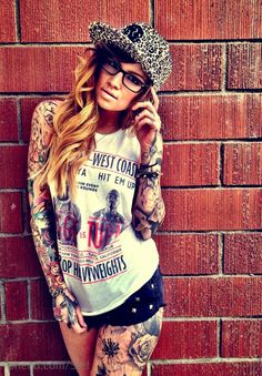 Love this photo i admire this because i love her swag and would love to be tatted like this im jus chicken.....