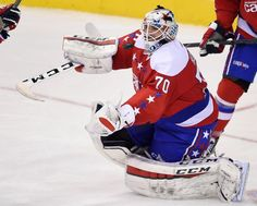Washington Capitals goalie Braden Holtby (70) watches the loose puck during the third period of an NHL hockey game against the Philadelphia Flyers, Sunday, Feb. 7, 2016, in Washington. The Capitals won 3-2. (AP Photo/Nick Wass)