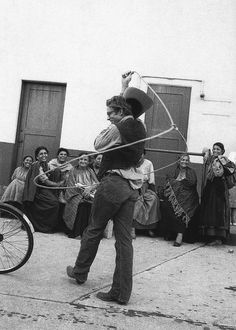 "jamesdean-withlove:  "" James Dean showing off his lasso skills on the set of 'Giant'  Photographed by Roy Schatt  Dated: 1954  """