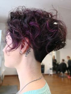 Natural curly hair with purple highlights