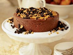Make this smooth-as-silk Chocolate Peanut Cheesecake topped with toasted peanuts and crunchy crumbled chocolate wafer cookies.