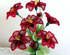 Items similar to Handmade Nylon Flower Arrangements in Colorful Glass Highballs on Etsy Nylon Flowers, Diy Flowers, Fabric Flowers, Red Rose Arrangements, Nylon Crafts, Poinsettia, Red Roses, Diy And Crafts, Vibrant Colors