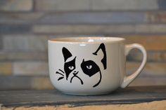 Hey, I found this really awesome Etsy listing at http://www.etsy.com/listing/156414242/grumpy-cat-coffee-mug