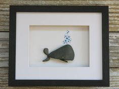 Takin It Easy Made of beach pebbles,glass rocks and ink! Comes in a black wooden frame with glass and is ready for wall or tabletop display! Frame measures about 11x9 and is matted to 6.5x4.5 Thanks for looking!:)