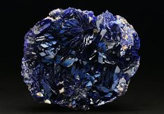 A very fine specimen of classic Chessy-les-Mines Azurite displaying excellent lustrous bladed deep blue crystals many displaying parallel habit filling a half egg-like specimen. The reverse of the specimen displays an almost neon blue colour.