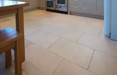Natural stone flooring is perfect for kitchen floors & counters, whether they are contemporary, traditional, minimalist or farmhouse. Stone Kitchen Floor, Kitchen Tiles, Kitchen Flooring, Kitchen Cabinets, French Pattern, Limestone Tile, Natural Stone Flooring, Natural Stones, Tile Floor