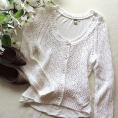 """Knitted+Knotted Tie back Cardigan Knitted + Knotted white cardigan from Anthropologie. Soft, lightweight sweater. Full length sleeve, attached tie can be wrapped to tie in front or back, fun pink stitching on buttons. Sz Sm. EUC  Length 22"""" Chest 16""""  Reasonable offers considered  ❌no offsite transactions/trades Anthropologie Sweaters"""