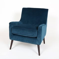 The Kristina Teal Accent Chair is perfect for any room of the house when you need an extra place for seating but don't have a ton of extra room. With tapered wood legs in an espresso finish, clean lines, dense foam cushions, and design that evokes a mid-c