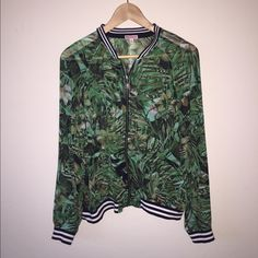Juicy Couture Tropical Chiffon Jacket OPEN TO REASONABLE OFFERS NWOT. Film is still on zipper. Chiffon material, with leaf/tropical print. Juicy Couture Jackets & Coats