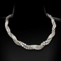 PIERRE STERLE.Paris, circa 1950's.An exceptional diamond ribbon twist necklace