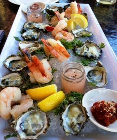 seafood platter of kumamoto oysters & jumbo poached shrimp at Lucy Restaurant, Bardessono Inn.