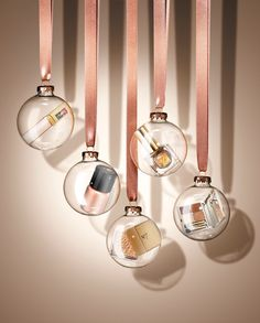 Still life photographer IanOliverWalsh.com  Beauty, Product, Cosmetic, Makeup, powder, varnish, lipstick, baubles, ribbon, festive