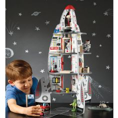 Toy Discovery Spaceship and Lift-off Wood Rocket - We have so much fun with this!  It was a Christmas present this year.  The top comes off and can zip around the room powered by parent power.