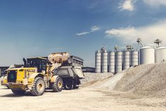 #clouds #daytime #equipment #excavator #gravel #heavy #heavy equipment #industrial area #large #loader #machine #machinery #outdoors #power #silos #sky #soil #technology #truck #vehicle #work