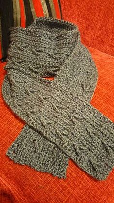 Crochet Young Men's Scarf This extra long scarf makes a great gift for a special guy in your life. (It also works for the ladies - it's super cozy!) Alternating post stitches create the look of directional arrows pointing westwards. Holding two strands of yarn together creates a tweedy look while also making this scarf extra warm to protect against a harsh winter. Ravelry.com
