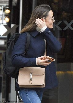 Sparkler:Also visible was Pippa's engagement ring, estimated to contain 3.5 carats surrounded by a halo of smaller diamonds and cost a whopping GBP £200,000