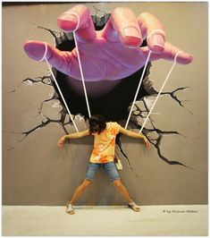 This awesome Urban graffiti art is by Mr Pilgrim. When standing in front of it, it appears as if you are a puppet on a string being manipulated by the large hand above.