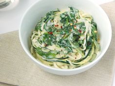 """Dinner is just minutes away and with these Zucchini Noodles with Lemon Garlic """"Cream"""" Sauce, no one will miss the dairy! You won't believe the secret ingredient!"""