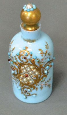 Antique blue glass perfume bottle, with applied jeweled jeweled decoration with turquoise and pearls. 19th century.